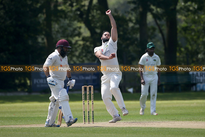 Hamzah Ikram in bowling action for Harold Wood during Wanstead and Snaresbrook CC vs Harold Wood CC, Hamro Foundation Essex League Cricket at Overton Drive on 17th July 2021