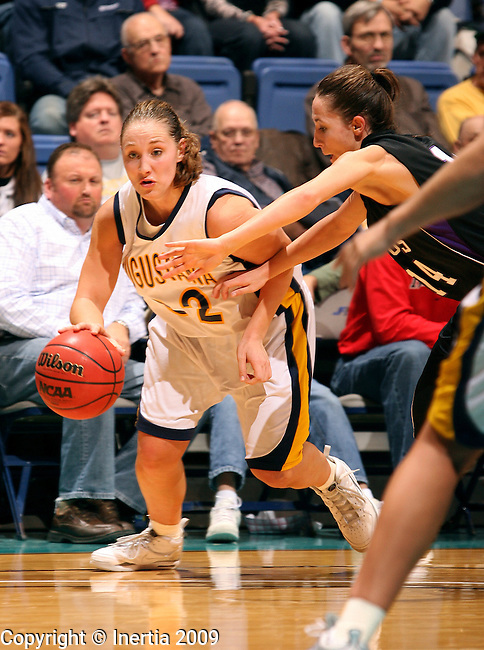 SIOUX FALLS, SD - NOVEMBER 18:  Megan Doyle #32 of Augustana College looks to drive past Chelsa Baxa #14 of the University of Sioux Falls in the second half of the 2009 Prairie Spirit Charitable Challenge Wednesday night at the Sioux Falls Arena. (Photo by Dave Eggen/Inertia)