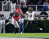 ATHENS, GA - NOVEMBER 09: Richard LeCounte #2 of the Georgia Bulldogs makes a run after his interception and is tackled by Jalani Williams #4 of the Missouri Tigers during a game between Missouri Tigers and Georgia Bulldogs at Sanford Stadium on November 09, 2019 in Athens, Georgia.