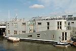 Nine Elms Wharf purpose bult boathouse. Floating home river Thames Battersea South London UK .
