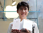 September 22, 2017, Tokyo, Japan - A customer smiles as he purchased Apple's new iPhone and Apple Watch Series 3 at an Apple store in Tokyo on Friday, September 22, 2017. The new iPhone 8 and 8 Plus featuring wireless battery charging are launched in Japanese market.    (Photo by Yoshio Tsunoda/AFLO) LWX -ytd-
