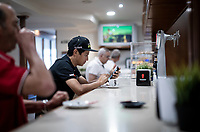 Esteban Chaves (COL/Mitchelton-Scott) having a coffee in the bar ahead of leaving the team hotel for the stage<br /> <br /> Stage 14: San Vicente de la Barquer to Oviedo (188km)<br /> La Vuelta 2019<br /> <br /> ©kramon