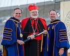 May 18, 2014; University of Notre Dame president Rev. John Jenkins, C.S.C., left, and Notre Dame Board of Trustees chairman Richard Notebaert, right, present an honorary degree to Cardinal Seán Patrick O'Malley, O.F.M. Cap. at the 2014 Commencement ceremony in Notre Dame Stadium.<br /> <br /> Photo by Matt Cashore/University of Notre Dame