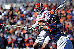 Face-Off Classic:  Midfielder Pat Harbeson #11 of the Virginia Cavaliers checks a cornell bear during the Virginia v Cornell mens lacrosse game at M&T Bank Stadium on March 10, 2012 in Baltimore, Maryland. (Ryan Lasek/Eclipse Sportswire)