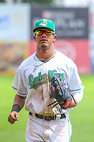 Clinton LumberKings outfielder Ariel Sandoval (15) heads to the dugout between innings during a Midwest League game against the Lansing Lugnuts on July 15, 2018 at Ashford University Field in Clinton, Iowa. Clinton defeated Lansing 6-2. (Brad Krause/Four Seam Images)