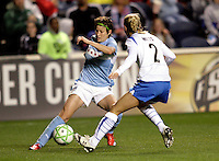 Chicago Red Stars midfielder Megan Rapinoe (8) maneuvers around Boston Breakers defender Heather Mitts (2).  Rapinoe would score on the play.  The Chicago Red Stars defeated the Boston Breakers 4-0 at Toyota Park in Bridgeview, IL on April 25, 2009.