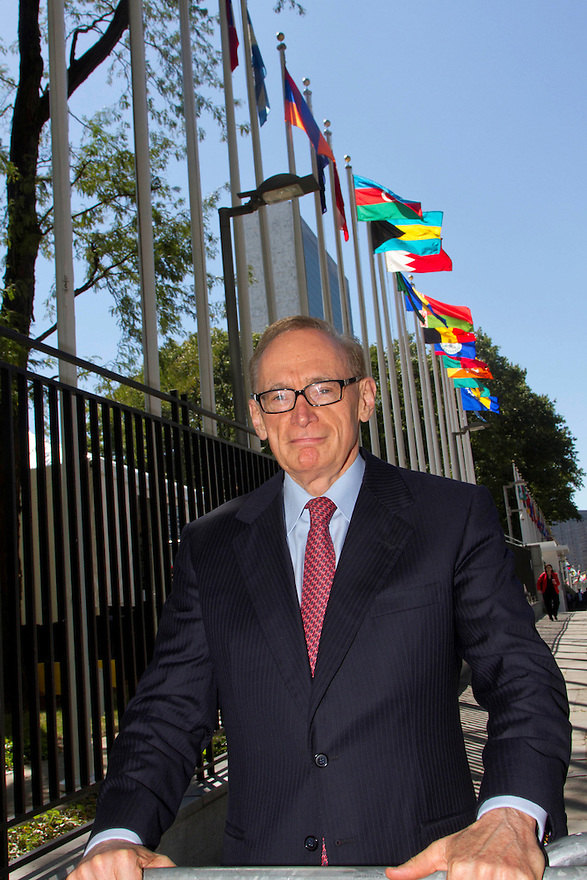 Australian Foreign Minister Senator Bob Carr talks with aides as he walks between meetings at United Nations Headquarters  in New York.  photo by Trevor Collens....