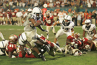 Miami, FL -- 1/3/2006 --  Penn State running back Austin Scott carries the ball during the Orange Bowl game in 2006.  Penn State defeated Florida State by a score of 26-23 in overtime.  Scott was charged on Friday, October 12, 2007, with raping a woman in his campus apartment during the early morning hours of October 5, 2007...Penn State 26.Florida State 23.