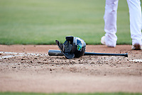 Lynchburg Hillcats helmet and bat at home plate after the final out of an inning during the first game of a doubleheader against the Potomac Nationals on June 9, 2018 at Calvin Falwell Field in Lynchburg, Virginia.  Lynchburg defeated Potomac 5-3.  (Mike Janes/Four Seam Images)