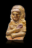 Ancient Egyptian Roman female mummy mask, limestone, Roman Period, 2nd Cent AD, Hawara,  Egyptian Museum, Turin. black background<br /> <br /> This is a remarkable gilt cartonnage with inlaid cystal eyes . The woman wears a Roman style hardo half covered by a veil, a himation, fringed cloak, yied to her breat, snake shaped bracelets and a necklace of pink flowers, all of which are connected to the cult of Isis.
