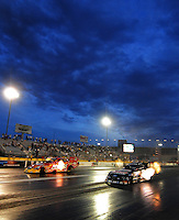 Nov. 1, 2008; Las Vegas, NV, USA: NHRA funny car driver John Force (right) races Cruz Pedregon during qualifying for the Las Vegas Nationals at The Strip in Las Vegas. Mandatory Credit: Mark J. Rebilas-