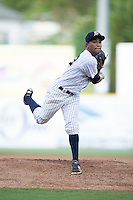 Pulaski Yankees starting pitcher Rafael Lara (12) follows through on his delivery against the Elizabethton Twins at Calfee Park on July 25, 2016 in Pulaski, Virginia.  The Twins defeated the Yankees 6-1.  (Brian Westerholt/Four Seam Images)