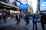 People celebrate with champagne during the Coinbase Global Inc. initial public offering (IPO) outside of the Nasdaq MarketSite in New York, U.S., on Wednesday, April 14, 2021. Photograph by Michael Nagle