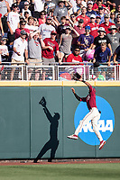 Florida State Seminoles outfielder JC Flowers (8) makes a leaping catch against the wall during Game 2 of the NCAA College World Series against the Arkansas Razorbacks on June 15, 2019 at TD Ameritrade Park in Omaha, Nebraska. Florida State defeated Arkansas 1-0. (Andrew Woolley/Four Seam Images)