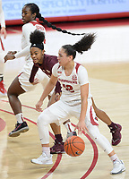 Arkansas guard Destiny Slocum (12) drives to the lane Thursday, Feb. 11, 2021, as Mississippi State guard Myah Taylor (center) fights through a screen from forward Erynn Barnum (top) during the first half of play in Bud Walton Arena. Visit nwaonline.com/210212Daily/ for today's photo gallery. <br /> (NWA Democrat-Gazette/Andy Shupe)
