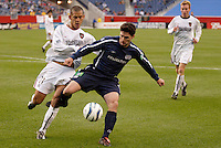 The MetroStars' Craig Ziadie and the  New England Revolution's Jay Heaps battle for the ball near the end line. The New England Revolution tied the NY/NJ MetroStars one all at Gillette Stadium, Foxborough, MA, on May 22, 2004.