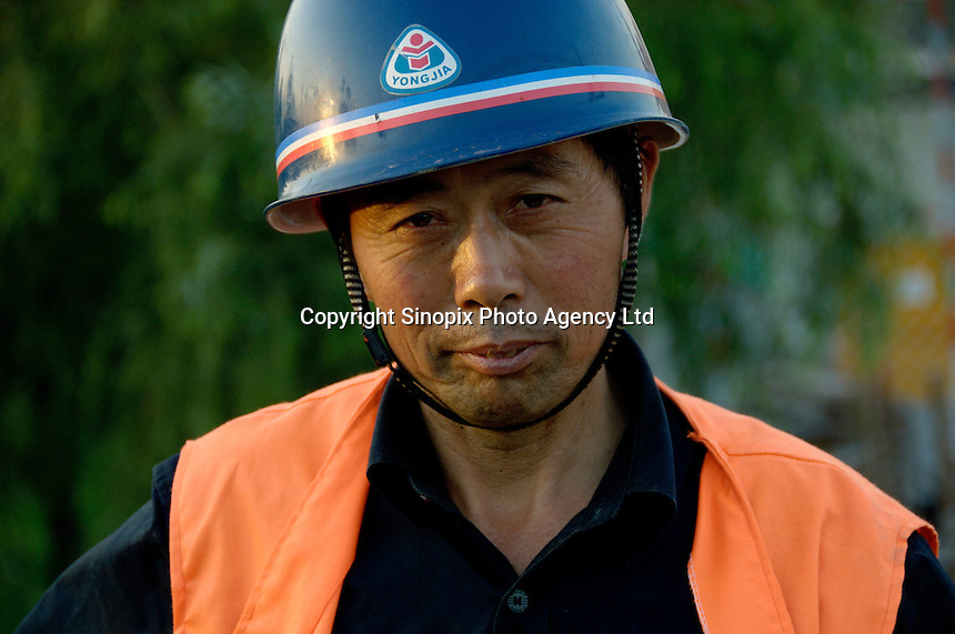 A worker at the construction site of Wukesong Indoor Stadium for 2008 Olympic Games in Beijing, China. China has promised to finish construction of the sporting facilities for the 2008 Olympic Games in apparently record time, aiming to complete all projects by the end of 2006. .