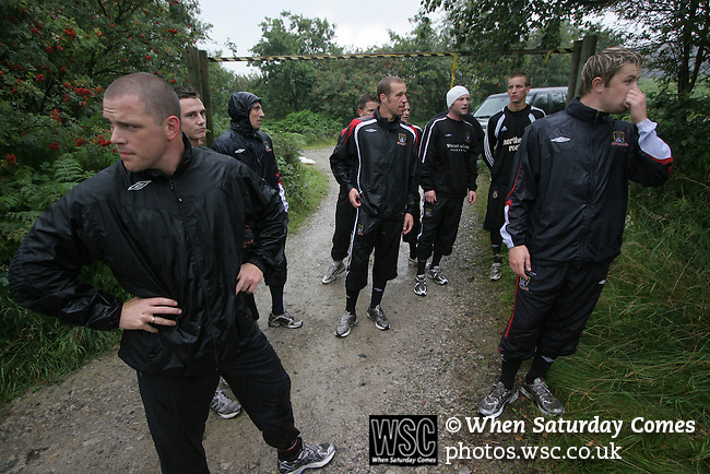 Players of Morecambe Football Club at the end of a pre-season training run on Clougha Pike, Lancashire. The squad was preparing for the club's first-ever season in the Football League having been promoted from the Conference the previous season.  Photo by Colin McPherson.