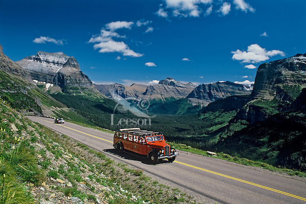 """Tour bus, Going-to-the-Sun road, Glacier N.P., MT.  (1930s red tour buses """"jammers"""", rebuilt in 2001 to run on propane or gas, offer tours on the road)"""