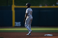 Liover Peguero (10) of the Greensboro Grasshoppers takes his lead off of second base against the Winston-Salem Dash at Truist Stadium on June 15, 2021 in Winston-Salem, North Carolina. (Brian Westerholt/Four Seam Images)