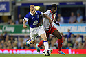 Oumare Tounkara of Stevenage grapples with Steven Naismith of Everton<br />  - Everton v Stevenage - Capital One Cup Second Round - Goodison Park, Liverpool - 28th August, 2013<br />  © Kevin Coleman 2013