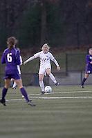 "Boston College midfielder Julia Bouchelle (12) traps the ball. In overtime, Boston College defeated University of Washington, 1-0, in NCAA tournament ""Elite 8"" match at Newton Soccer Field, Newton, MA, on November 27, 2010."