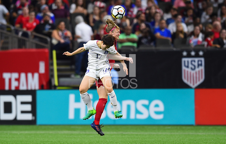 New Orleans, LA - Thursday October 19, 2017: Yoo Younga, Becky Sauerbrunn during an International friendly match between the Women's National teams of the United States (USA) and South Korea (KOR) at Mercedes Benz Superdome.
