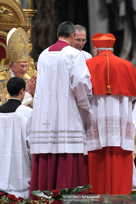 Italian newly appointed Cardinal Domenico Bartolucci (R) gets his biretta, the square red hat symbolising the blood of the martyrs, from Pope Benedict XVI (L) on November 20, 2010 during a consistory at St Peter's basilica at The Vatican. 24 Roman Catholic prelates joined today the Vatican's College of Cardinals, the elite body that advises the pontiff and elects his successor upon his death
