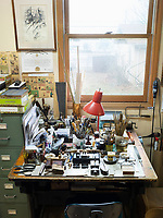 A table full of tools and equipment in the workshop of the Dale Guild Foundry.