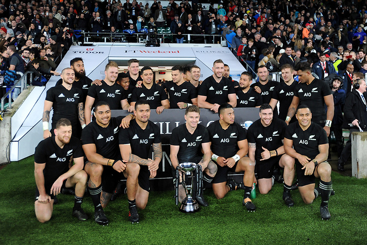 Captain Beauden Barrett of New Zealand and team mates celebrate winning the Killik Cup during the 125th Anniversary Match between Barbarians and New Zealand at Twickenham Stadium on Saturday 4th November 2017 (Photo by Rob Munro/Stewart Communications)