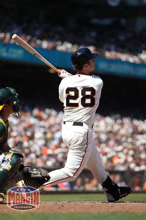 SAN FRANCISCO, CA - MAY 19:  Buster Posey #28 of the San Francisco Giants doubles in the bottom of the seventh inning to drive in a run against the Oakland Athletics during the game at AT&T Park on Saturday, May 19, 2012 in San Francisco, California. Photo by Brad Mangin