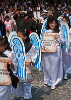 """Antigua, Guatemala.  Women Representing Angels Marching in Good Friday Procession, La Semana Santa.  """"Today you will be with me in Paradise."""""""