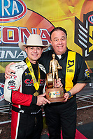 Feb 23, 2020; Chandler, Arizona, USA; NHRA top fuel driver Steve Torrence celebrates with sponsor Al Rondon after winning the Arizona Nationals at Wild Horse Pass Motorsports Park. Mandatory Credit: Mark J. Rebilas-USA TODAY Sports