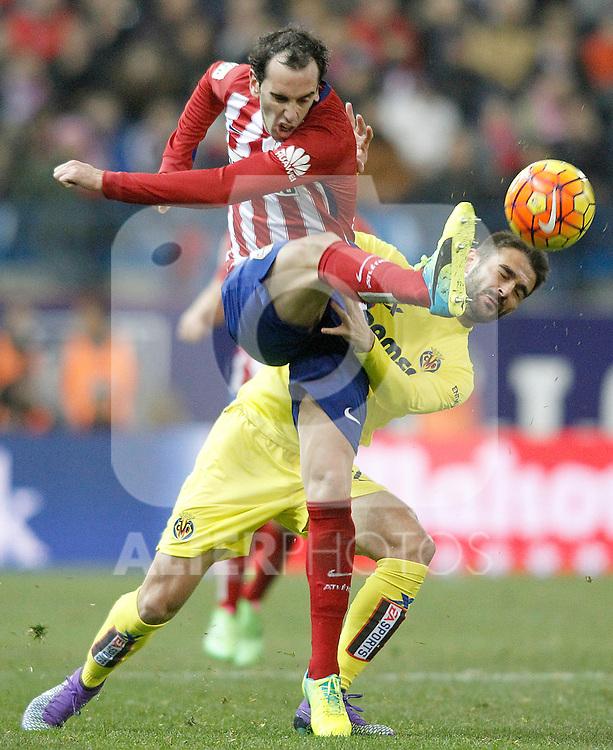 Atletico de Madrid's Diego Godin (l) and Villareal's Adrian Lopez during La Liga match. February 21,2016. (ALTERPHOTOS/Acero)