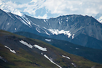 Layers of tundra, ridges and the Alaska Range in the early summer high in Denali National Park, Alaska.