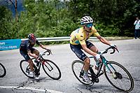 yellow jersey / GC leader Alexey Lutsenko (KAZ/Astana - Premier Tech) up the climb towards La Plagne (HC/2072m/17.1km@7.5%)  followed closely by the man who will be taking the jersey off him a few kilometers further up; Richie Porte (AUS/Ineos Grenadiers)<br /> <br /> 73rd Critérium du Dauphiné 2021 (2.UWT)<br /> Stage 7 from Saint-Martin-le-Vinoux to La Plagne (171km)<br /> <br /> ©kramon