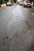 Burst water main in a street in Camden, London.