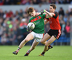 Dermot Coughlan of Kilmurry Ibrickane in action against Brian Carrig of Clondegad during their senior county final at Cusack park. Photograph by John Kelly.