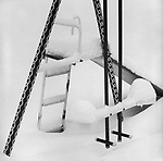 Scan from vintage print. Graphic of swing set in snow. Negative file #82-126. 1982; 1 of 1
