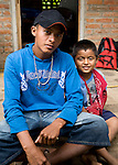 Two Nicaraguan boys sit on a step in Los Cabillitos del Mar, Isla Ometepe, Nicaragua