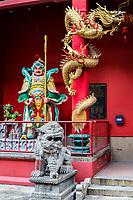 Guan Di (Kuan Ti) Taoist Temple, with Warrior, Lion, and Dragon Guarding Entrance, Chinatown, Kuala Lumpur, Malaysia.