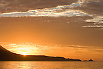 San Clemente Island, Channel Islands, California; sunrise from behind Pyramid Head on Pyramid Cove at the southern end of San Clemente Island
