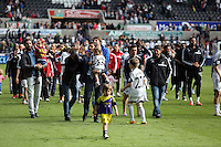 Saturday, 03 May 2014<br /> Pictured: Swansea players and backroom staff greet home supporters after the end of the game.<br /> Re: Barclay's Premier League, Swansea City FC v Southampton at the Liberty Stadium, south Wales.
