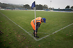 Ramsbottom United 1 Barwell 3, 03/10/2015. Riverside Stadium, Northern Premier League. A volunteer collecting a corner flag at the Harry Williams Riverside Stadium at the conclusion of the Northern Premier League premier division match between Ramsbottom United and Barwell. This was the club's 13th league game of the season and they were still to record their first victory following a 3-1 defeat, watched by a crowd of 176. Rams bottom United were formed by Harry Williams, the current chairman, in 1966 and progressed from local amateur football  in Bury to the semi-professional leagues. Photo by Colin McPherson.