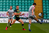 13th March 2021; Franklin's Gardens, Northampton, East Midlands, England; Premiership Rugby Union, Northampton Saints versus Sale Sharks; AJ MacGinty of Sale Sharks clears the ball under pressure from Ollie Sleightholme of Northampton Saints