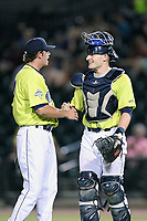 Pitcher Allan Winans (28) of the Columbia Fireflies is congratulated by catcher Hayden Senger (15) after securing the save in a game against the Augusta GreenJackets on Thursday, July 11, 2019 at Segra Park in Columbia, South Carolina. Columbia won, 5-2. (Tom Priddy/Four Seam Images)