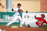 Jupiter Hammerheads shortstop Justin Bohn (10) throws to first base as Casey Grayson (29) slides in during a game against the Palm Beach Cardinals on August 13, 2016 at Roger Dean Stadium in Jupiter, Florida.  Jupiter defeated Palm Beach 6-2.  (Mike Janes/Four Seam Images)