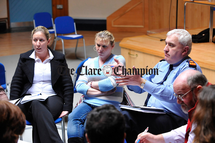 """Bridget Sherlock and Kathleen Mc Donagh listen as Superintendent John Scanlan speaks during a group discussion at the launch of """"experiences and Perspectives of Ennis Travellers of the County Clare Traveller Accomodation Programme 2000-2004. Photograph by John Kelly."""