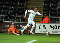 Pictured: Thomas Butler of Swansea (R) avoids a tackle by Marcel Seip of Plymouth<br /> Picture by D Legakis / Athena Picture Agency, Swansea, 07815441513