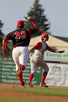 Williamsport Crosscutters Cesar Hernandez is chased back and eventually tagged out by Jon Rodriguez (28) during the first game of a double header vs. the Batavia Muckdogs at Dwyer Stadium in Batavia, New York;  August 25, 2010.   Batavia defeated Williamsport 4-3.  Photo By Mike Janes/Four Seam Images